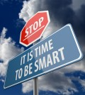 Stop and It is Time to be Smart words on Road Sign