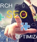 Businessman pointing at SEO (search engine optimization)